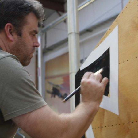 Paul Painting Iron Cross On Vertical Stabilzer
